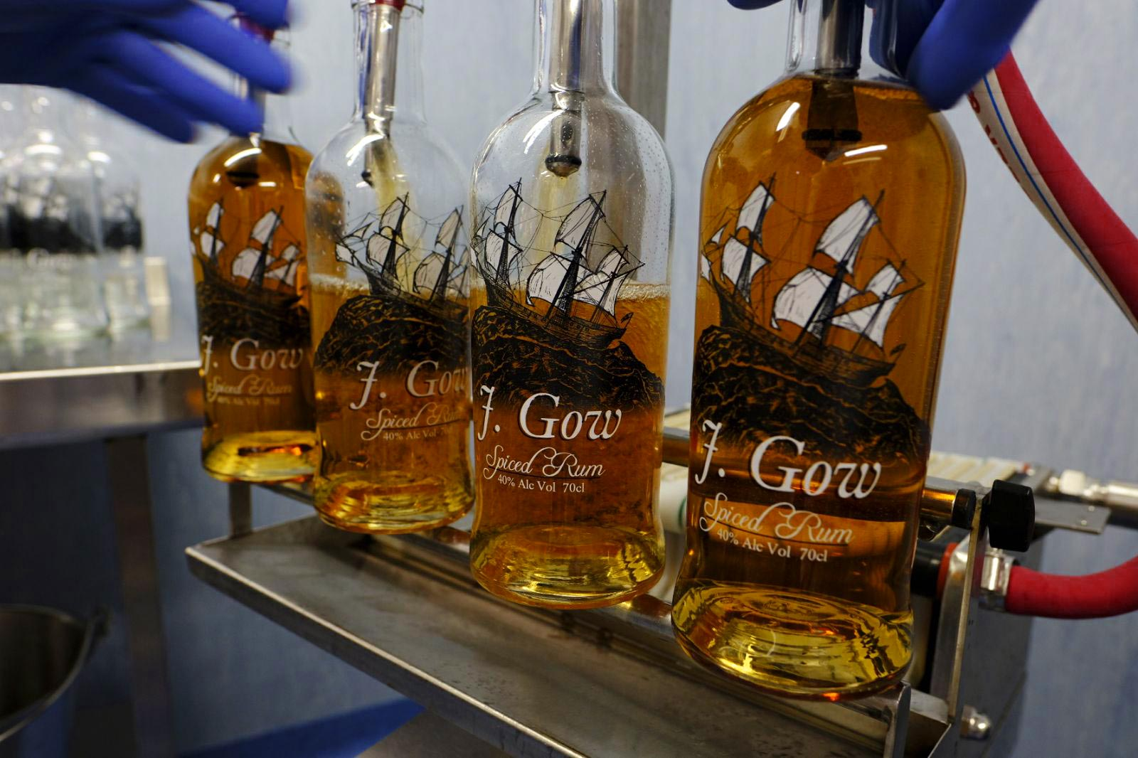 j gow spiced rum being filled