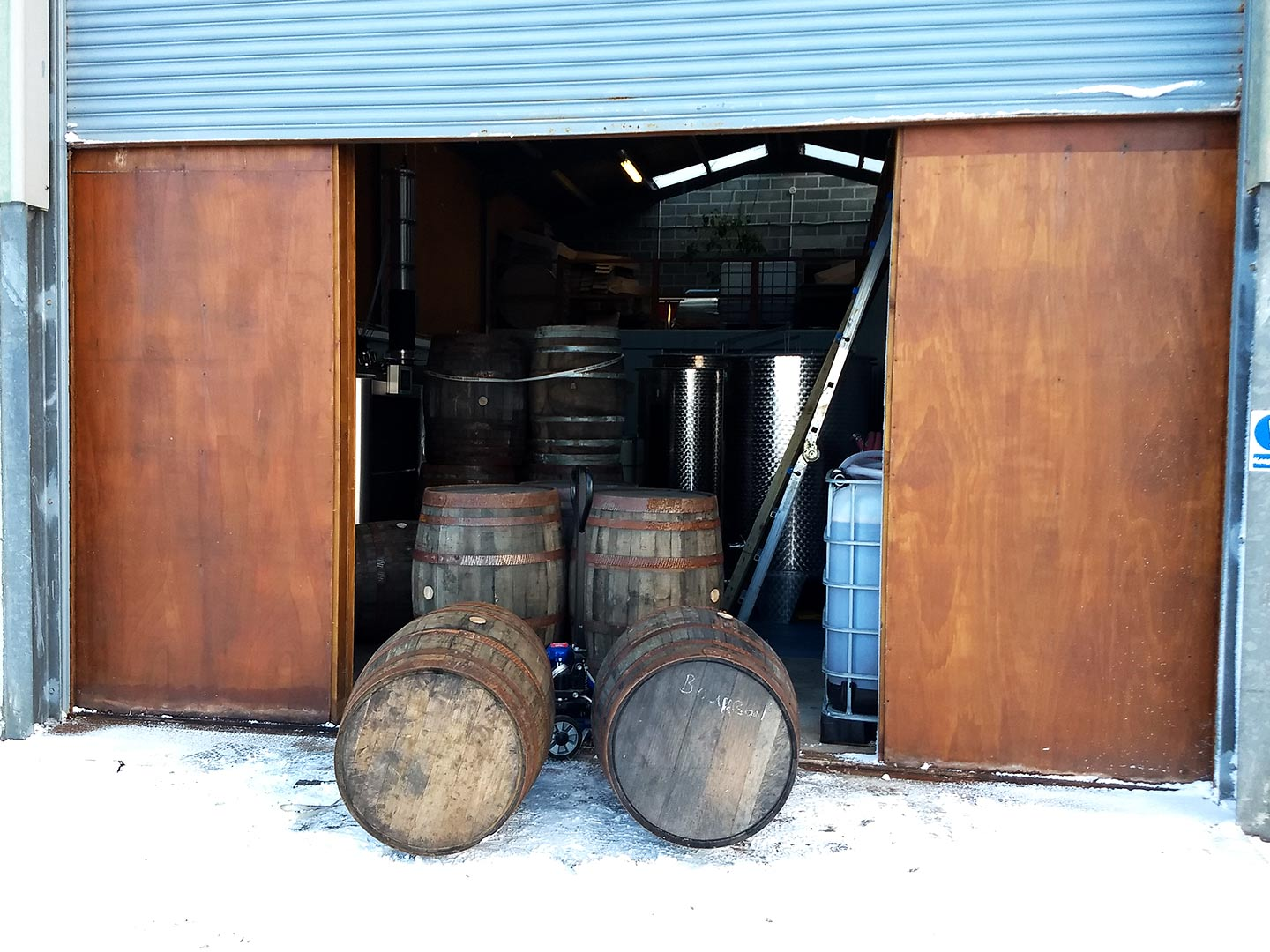 j gow rum barrels in the snow
