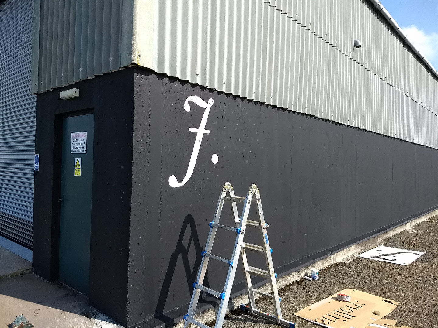 j gow rum distillery being painted