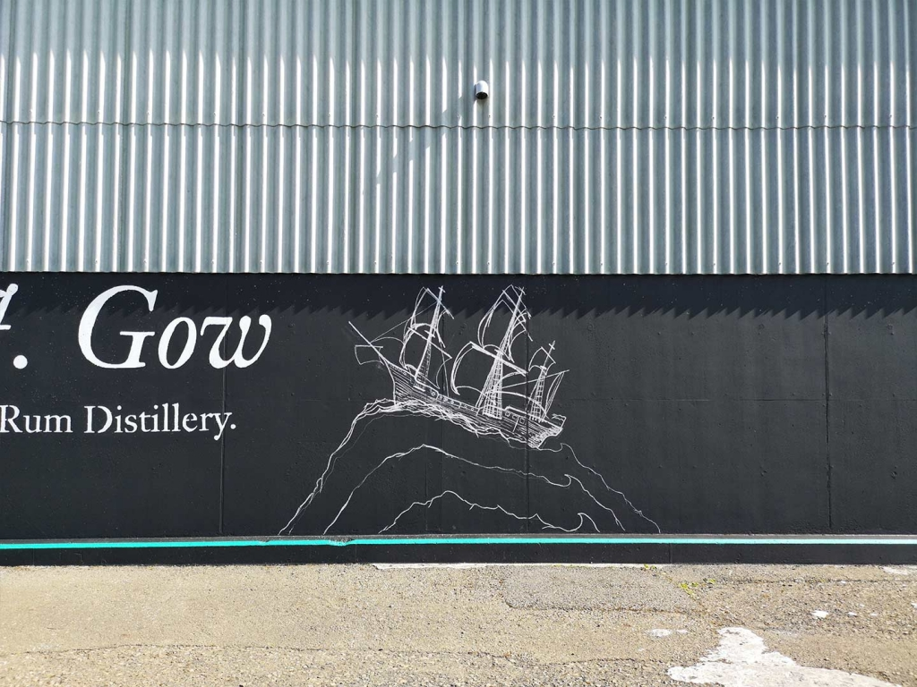 J. Gow Scottish rum distillery ship and wave logo chalk outline
