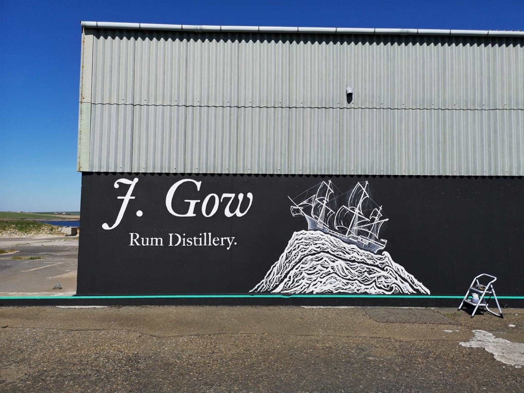 J. Gow Scottish rum distillery ship logo being painted