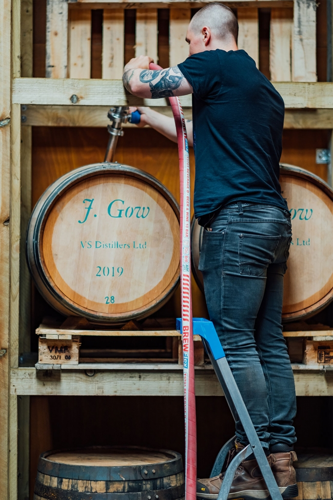 Oak cask being filled with scottish rum by the J Gow head distiller.